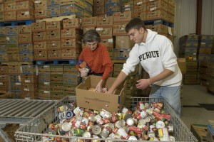 Volunteers sort canned foods at Food Finders Food Bank of Lafayette