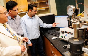 Arvind Varma, Purdue Chemical Engineer, reviews data for new process.