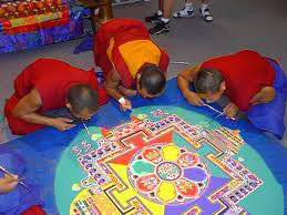 Tibetan monks make sand mandala