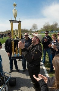 Penix raises trophy to the crowds after winner the 54th Purdue Grand Prix