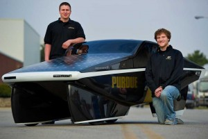 Pesyna, Kelley pose with the Purdue Solar Racing Car